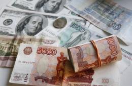 МЭР РФ скорректирует прогноз курса рубля к доллару на 2015 год в сторону ослабления
