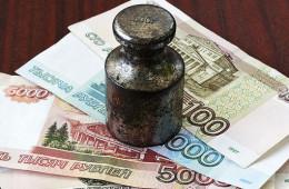 Долги давят на рубль, но нефть важнее